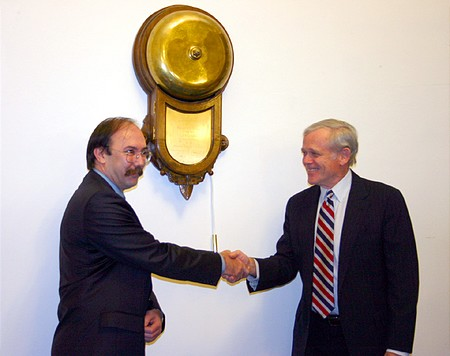 Zsolt Horváth congratulates William H. Donaldson for the ringing