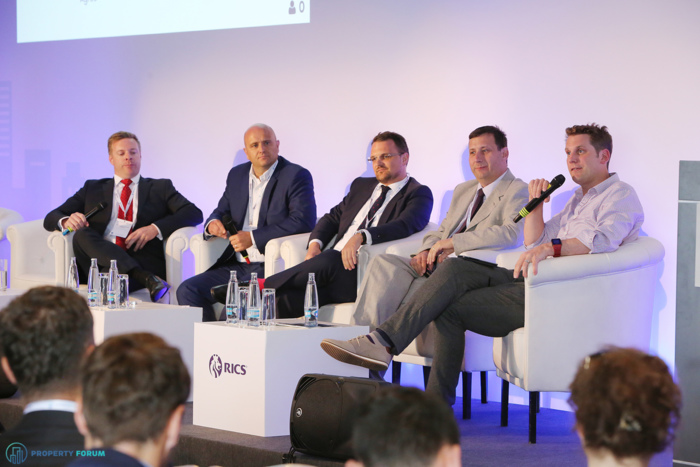 Innovation vs. people: the future of valuation and the advisory business. Fraser Watson MRICS (Head of Valuation & Consultancy, Savills Czech & Slovak Republics), Stewart Thomson MRICS (Country Head for Czech Republic, BNP Paribas Real Estate), Marcel Kolesar MRICS (Head of Valuation, Colliers International), David Dušek PhD. (Head of Real Estate Valuation Section, UniCredit Bank Czech Republic and Slovakia, a.s.), and the chair James Dearsley (Founder, The Digital Marketing Bureau)